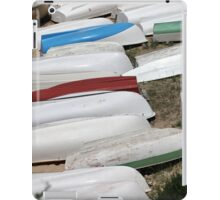 pile rowing boats on the shore iPad Case/Skin