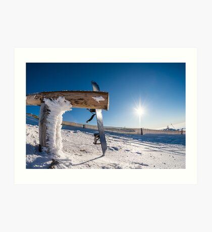 Snowboard leaning on a wood rail Art Print