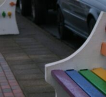 Colourful benches on a dull day Sticker