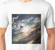 Atmospheric silhouette plane amongst stormy moody clouds Unisex T-Shirt