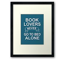 Book Lovers Never Go To Bed Alone Framed Print