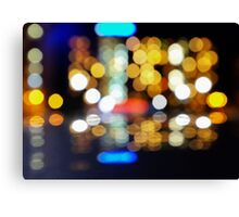 bokeh of city lights in the background Canvas Print