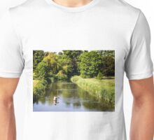 A fly fisherman casting on the River Nadder, Wiltshire, England Unisex T-Shirt
