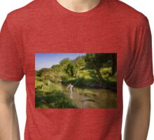 A fly fisherman casting on the River Wylye, Wiltshire, England Tri-blend T-Shirt