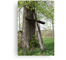 Old Catholic Christian wooden cross by  tree Canvas Print