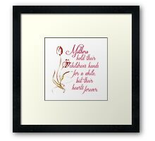 Mothers hold their children's hands... Framed Print