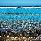 gentle soft waves lashing onto ballybunion sandy beach by morrbyte