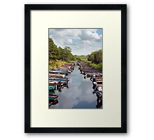 rowing boats moored at ross castle Framed Print