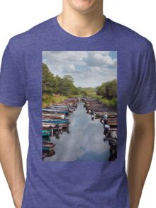rowing boats moored at ross castle Tri-blend T-Shirt