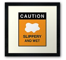 CAUTION SLIPPERY AND WET Framed Print