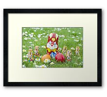Wrapped Chocolate Bunnies with Easter Eggs in the Grass Framed Print