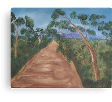 Gum trees along a dirt road. Canvas Print
