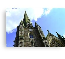 beautiy looking up at the sky by a church  Canvas Print