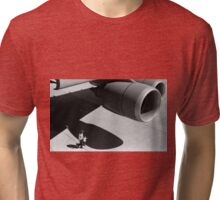 In the shade of a C-5M Super Galaxy Tri-blend T-Shirt