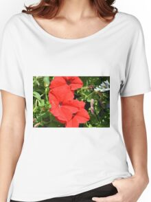 Red flowers on green leaves background. Women's Relaxed Fit T-Shirt