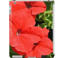 Red flowers on green leaves background. iPad Case/Skin
