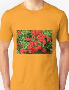 Bush of red flowers and green leaves. T-Shirt