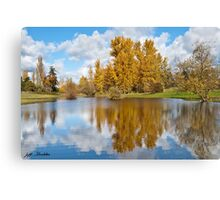 Fall Colors and Clouds Reflected in a Pond Canvas Print