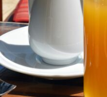 Glass of orange juice on the table. Sticker