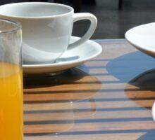 Breakfast with tea, orange juice and omelette.  Sticker