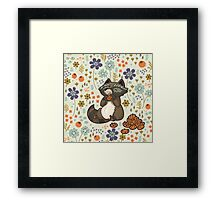 Funny little raccoon eating cookies Framed Print