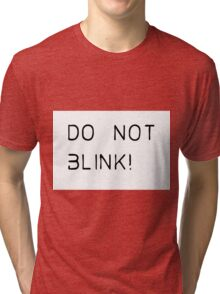 do not blink! Tri-blend T-Shirt