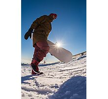 Snowboarder walking against blue sky Photographic Print
