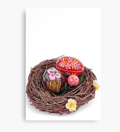 hand painted easter eggs in nest Canvas Print