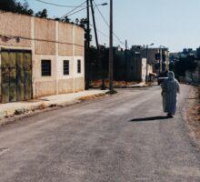 Muslim Woman Walking Down Quiet Street Sticker