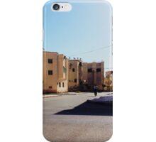 Man Riding Bicycle Through Moroccan Suburb iPhone Case/Skin