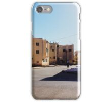 Man Riding Bicycle Through Moroccan Suburb iPhone Case/Skin