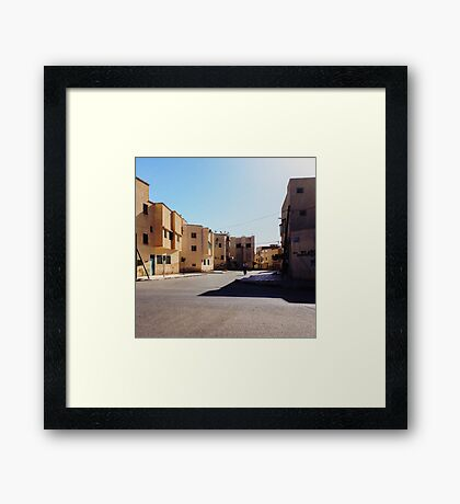 Man Riding Bicycle Through Moroccan Suburb Framed Print