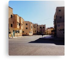 Man Riding Bicycle Through Moroccan Suburb Canvas Print