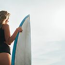 Rio de Janeiro - Pretty Blond Female Surfer Girl Standing Next to Surfboard in Warm Morning Light by visualspectrum