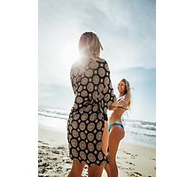 Two Young Pretty Blond Girls Holding Hands and Laughing Together on Sunny Beach Photographic Print