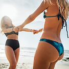 Two Young Pretty Blond Girls Having Fun Together on Sunny Beach by visualspectrum