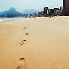 Footprints in Sand on Ipanema Beach in Rio de Janeiro Brazil by visualspectrum