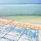 Colorful Sidewalk Near Tropical Ocean by visualspectrum