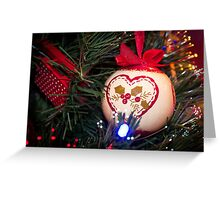 Red Christmas ornament retro ball hanging on Christmas tree with holly Greeting Card