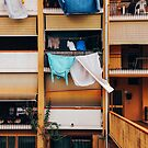 Vintage Building Facade with Drying Laudry on Balcony in Italy by visualspectrum