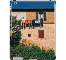 Laundry Drying on Washing Line Against Old Brick Building in Tuscany Italy iPad Case/Skin
