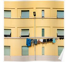 Laundry Drying on Washing Line Against Yellow Building Facade in Italy Poster