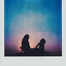Polaroid of Mother and Child Sitting on Camper Van Roof by visualspectrum
