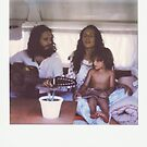 Polaroid of Young Hippie Family Singing Inside Camper Van by visualspectrum