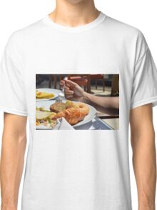 Man eating breakfast, plate with croissant, omelette, bread. Classic T-Shirt