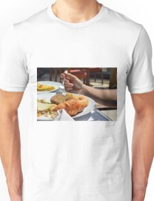 Man eating breakfast, plate with croissant, omelette, bread. Unisex T-Shirt