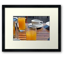 Coffee cup and orange juice breakfast drinks. Framed Print
