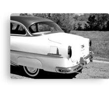 Classic car on the move Canvas Print