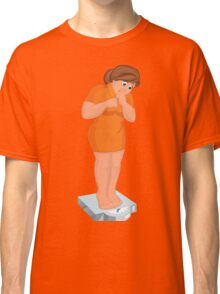 Cartoon young fat woman in orange dress barefoot looking at the scale Classic T-Shirt