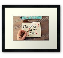 One Thing At A Time Framed Print